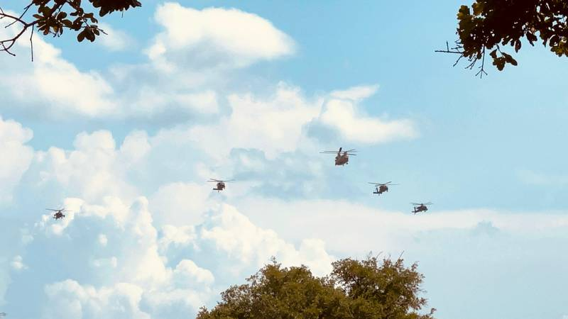 Five 1st Air Cavalry Brigade helicopters were flying above Aggieland today to practice for...