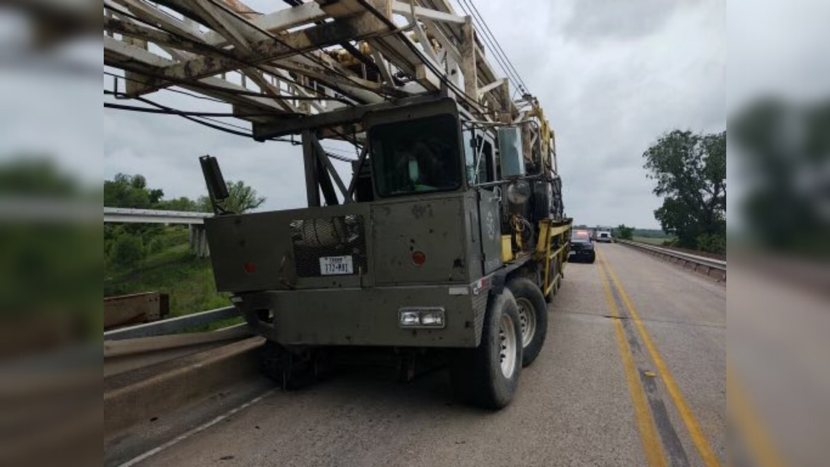 A crane truck crashed into a guard rail on SH 105