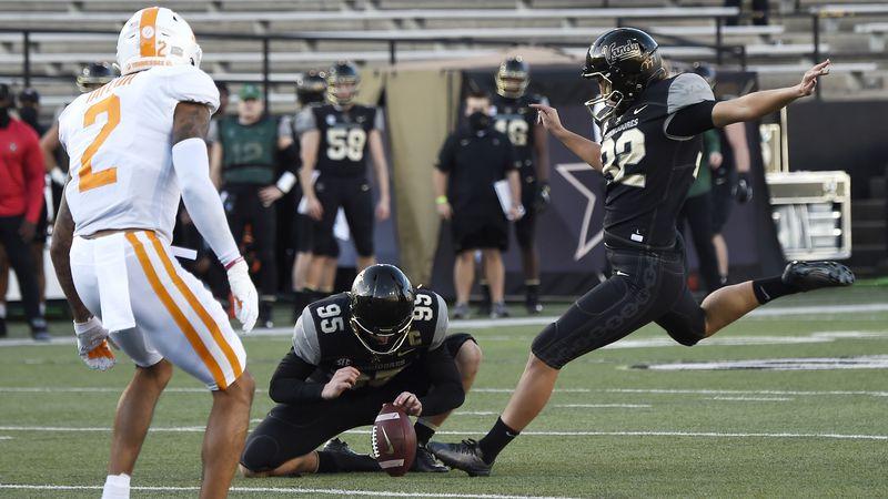 Vanderbilt place kicker Sarah Fuller (32) kicks an extra point during the first quarter of an...