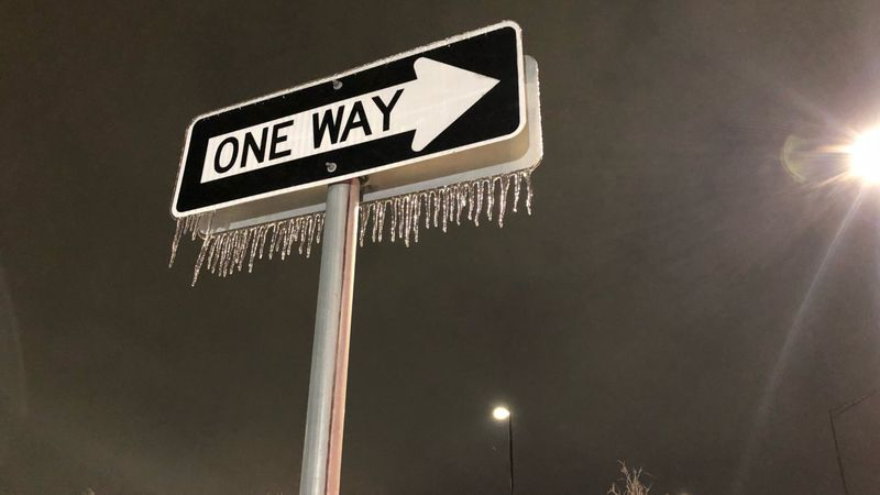 Icicles dangle from a road sign in College Station on February 18, 2021.