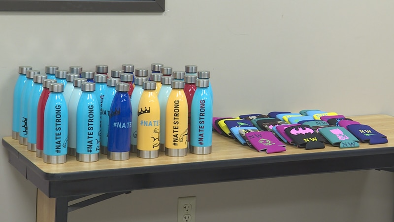These bottles and koozies were made by hand and sold to help Kent Moore Cabinets shooting...
