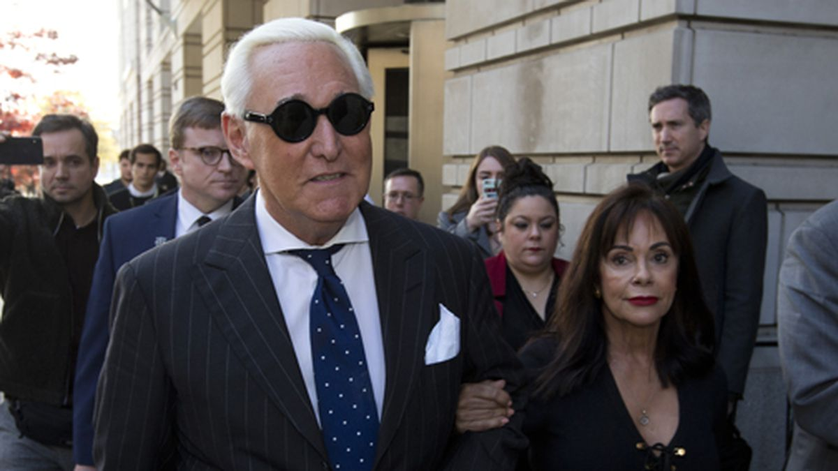In this Nov. 15, 2019 file photo, Roger Stone, left, with his wife Nydia Stone, leaves federal...