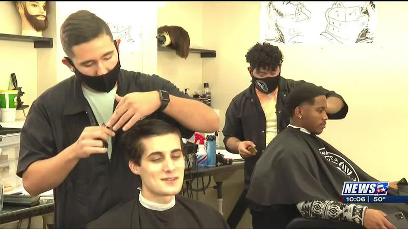 Barber and beauty school host food drive in exchange for free haircuts