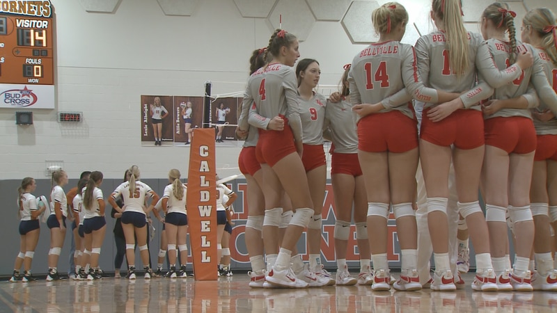 The Bellville and Caldwell volleyball teams huddle up during their match at Hornet Gym.