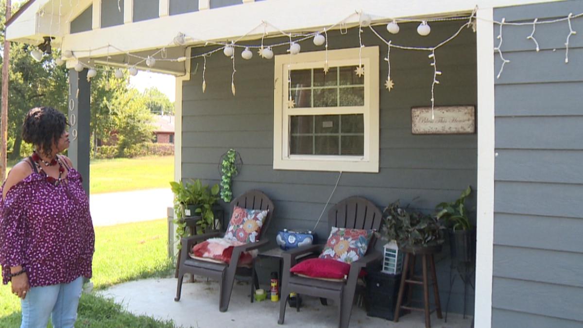 Margie Brown admires her home