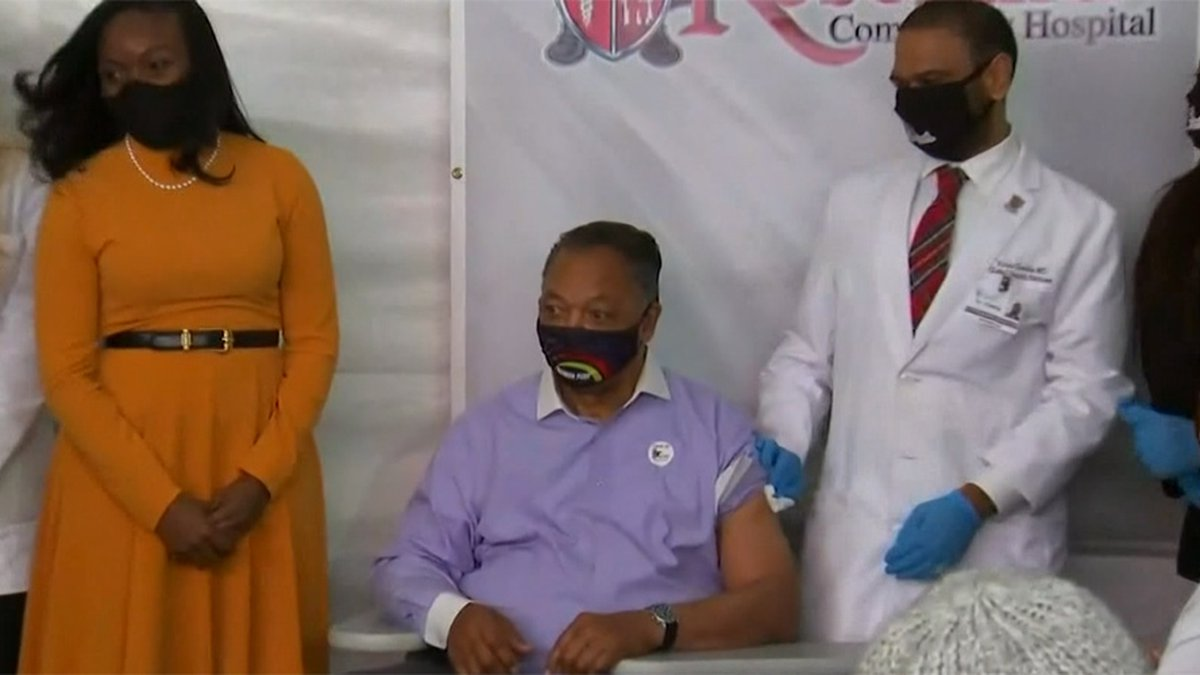 The Rev. Jesse Jackson, center, shown after being vaccinated, is headed home a month after he...