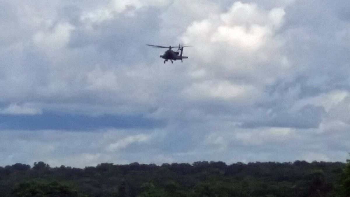 A helicopter in the air over the search area Friday. (Photo by Sam DeLeon)