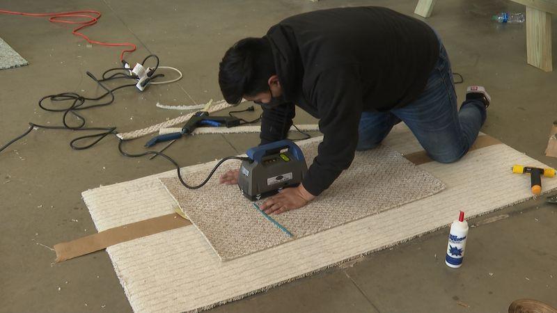 Bryan CTEC student learning carpet instillation.