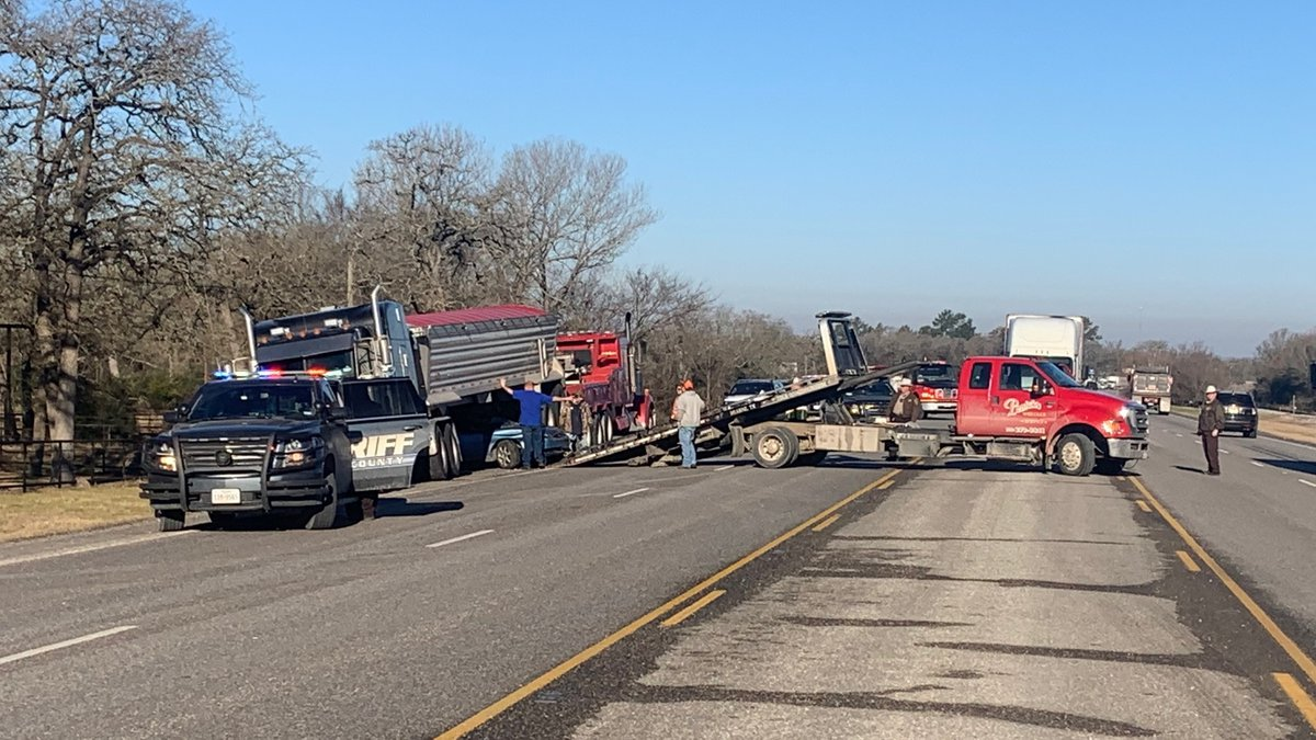 Officials are investigating a crash between an 18-wheeler and a car early Monday morning