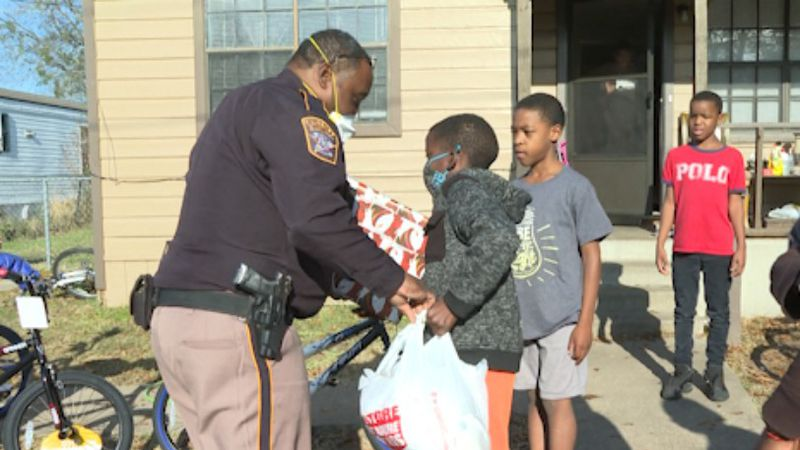 BCSO gives out gifts to community for annual Adopt a Family event.