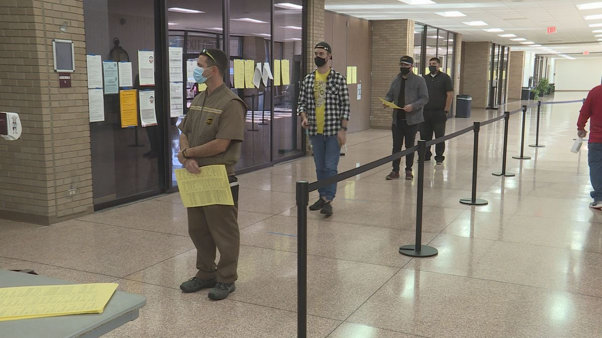 Voters line up inside the Brazos Center just after 9 a.m. on Election Day to cast their ballots.