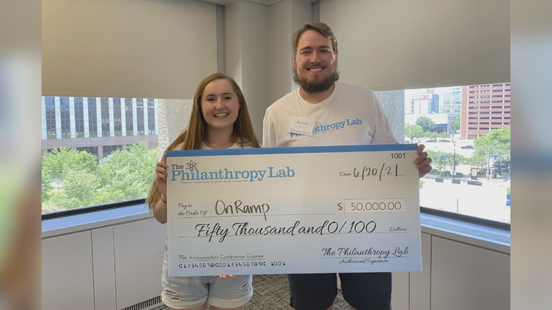 Texas A&M students Bryce Alverson and Victoria Evans show off the $50,000 check that was...