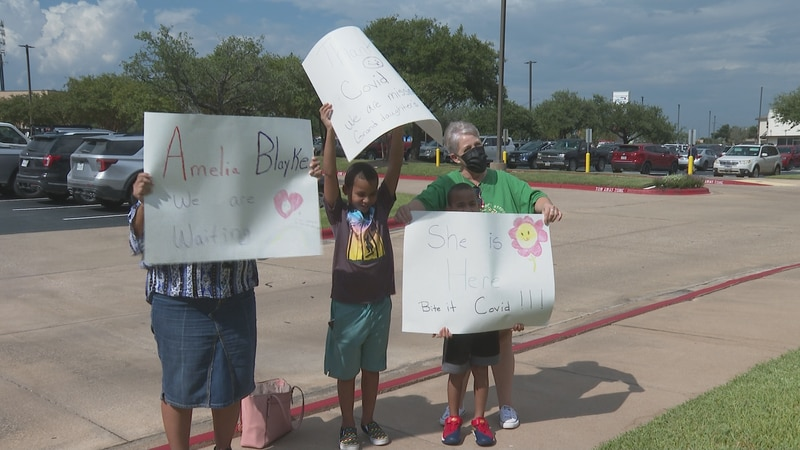 The Haveron and Gonzales family stood outside of the hospital cheering on their newest family...