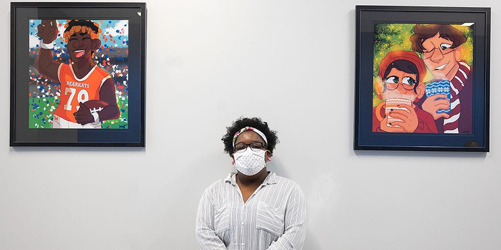 Sam Houston State University student Jada Jackson with two of the eight pieces of her art...