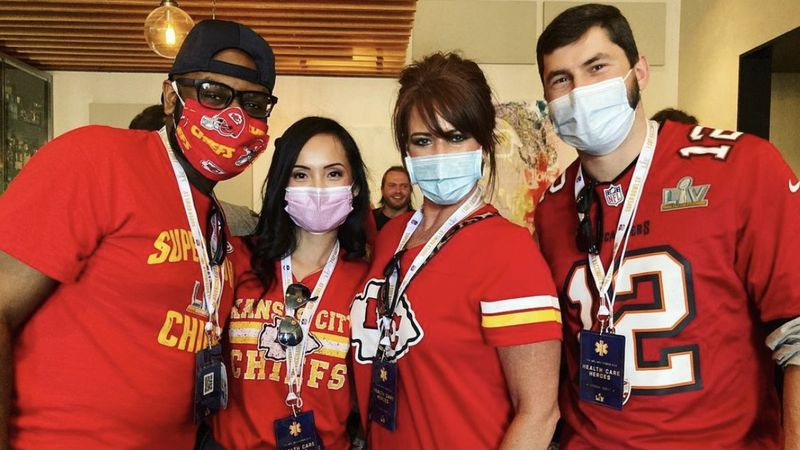 Tony Neal (left) poses with other healthcare workers at Super Bowl LV on Sunday.