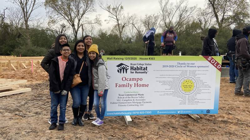 Marissa Ocampo and her four children at the start of their Habitat for Humanity journey.