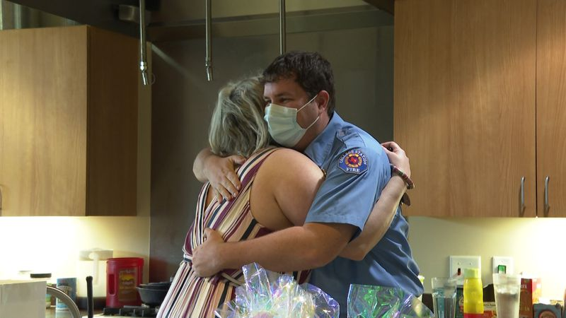 Kirstie Karonka and one of the first responders that helped save her life.
