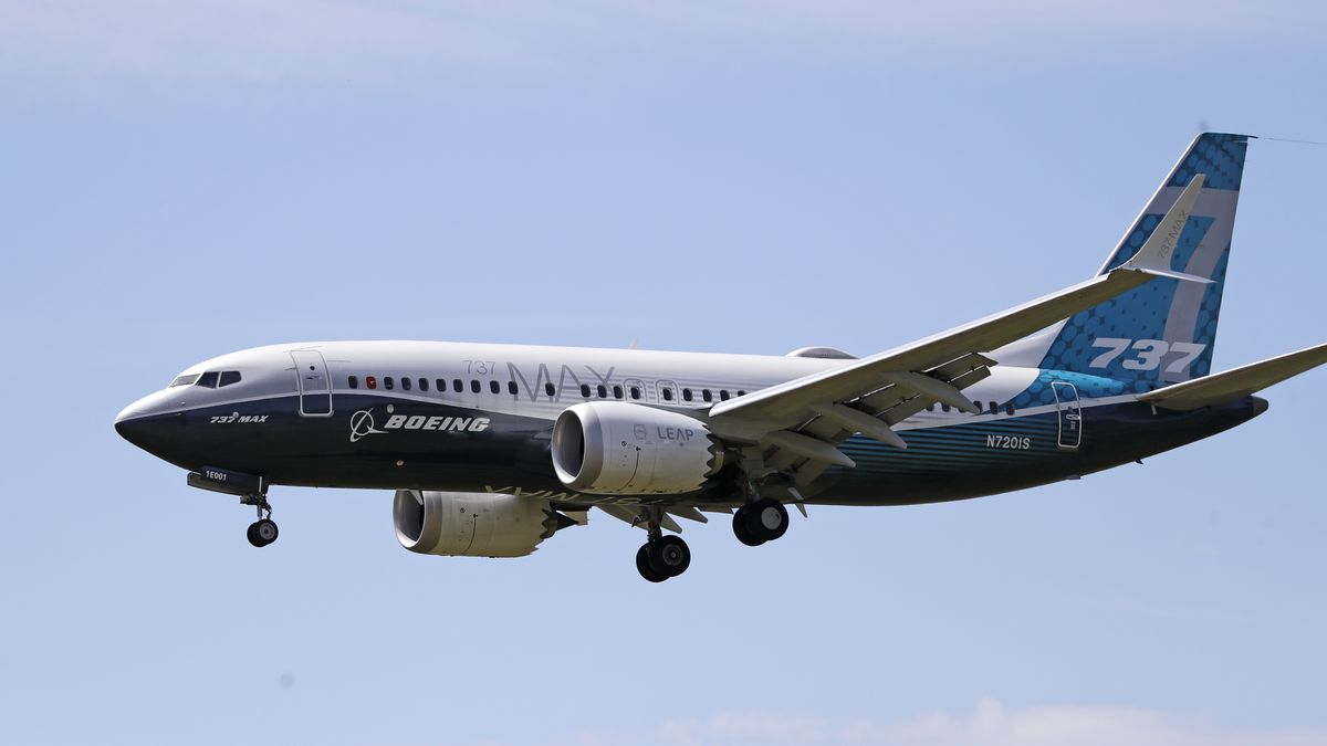 A Boeing 737 MAX jet heads to a landing at Boeing Field following a test flight Monday, June 29, 2020, in Seattle. Federal regulators on Monday, Aug. 3, 2020 outlined a list of design changes they will require in the Boeing 737 Max to fix safety issues that were discovered after two deadly crashes that led to the worldwide grounding of the plane.