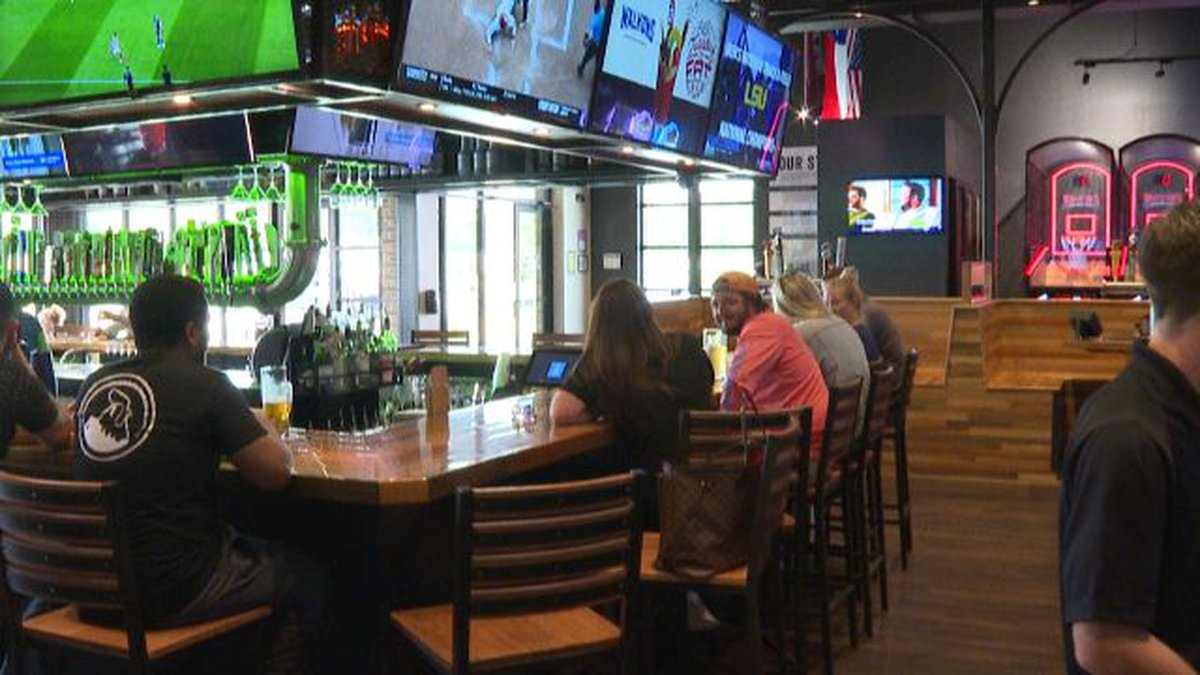 Customers sit at the bar at Walk-On's in College Station.