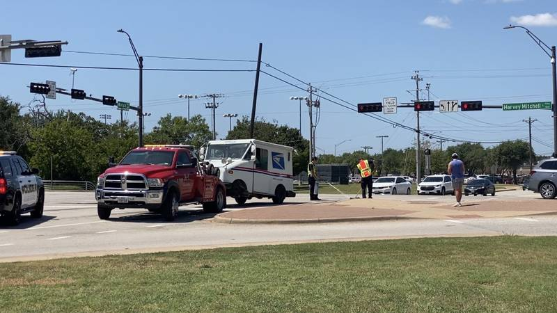 The crash involving a mail truck occurred at the intersection of Harvey Mitchell Parkway and...