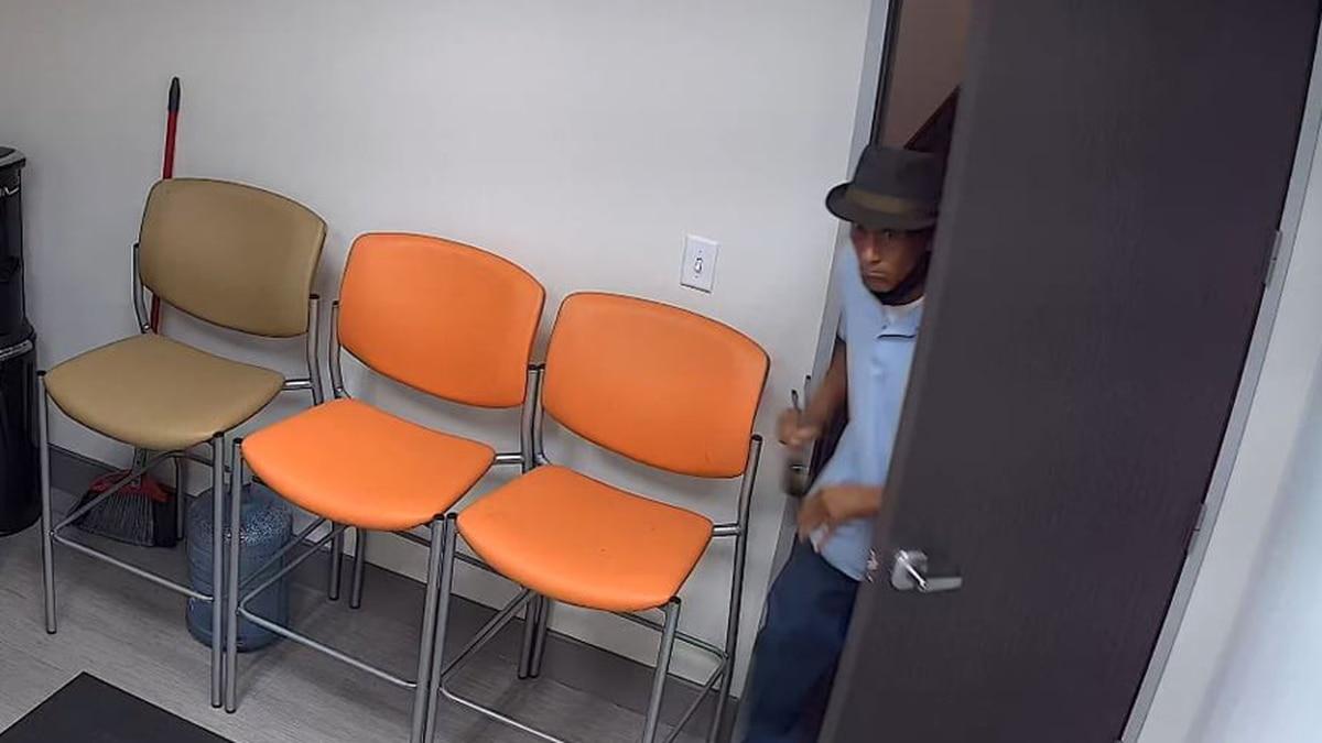 Surveillance video of the fedora-wearing burglar