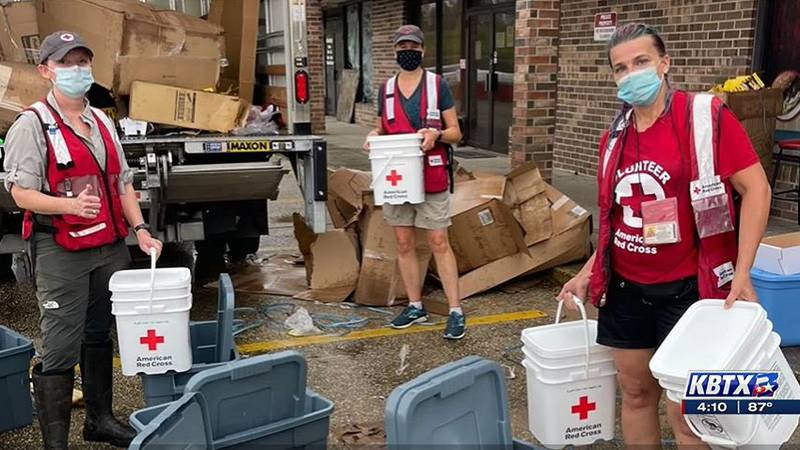 A.J. Renold and other members of the Red Cross assist with food, shelter and other needs from...