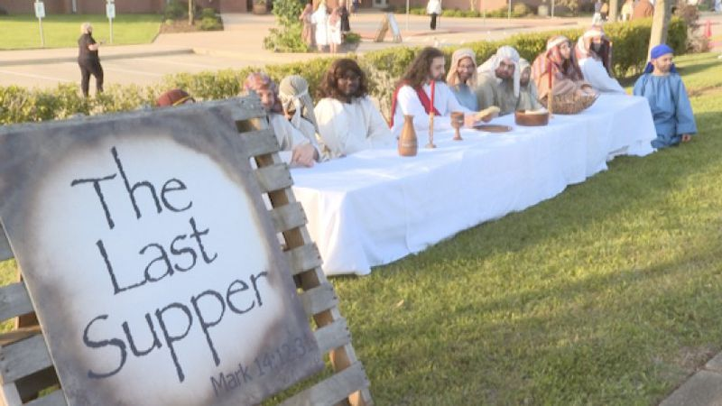 Volunteers dress up to show The Last Supper as a part of a living passion of the Christ on Good...