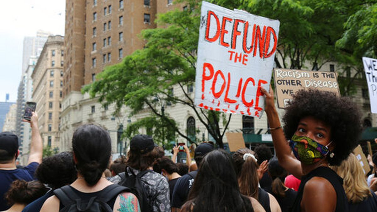 FILE - In this June 6, 2020, file photo, protesters march in New York. Since Floyd's killing, police departments have banned chokeholds, Confederate monuments have fallen and officers have been arrested and charged. The moves come amid a massive, nationwide outcry against violence by police and racism. (AP Photo/Ragan Clark, File)