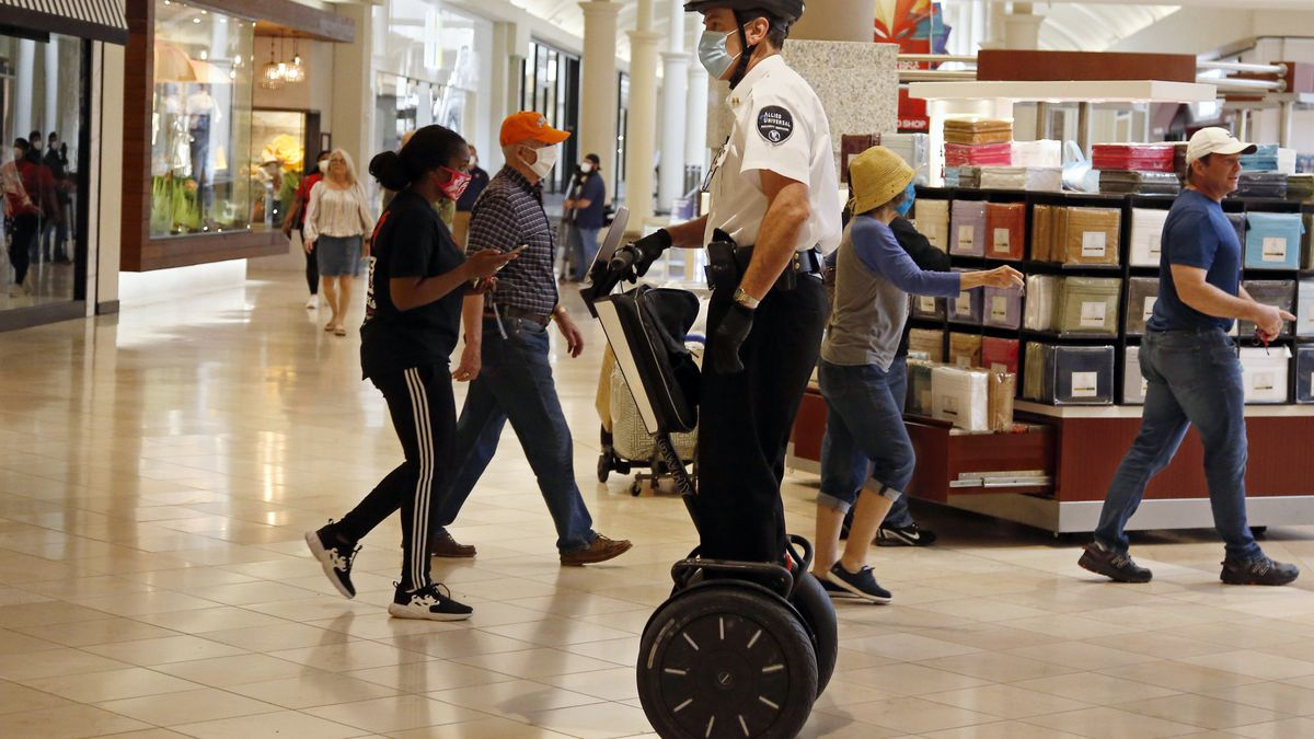 FILE - In this May 1, 2020 file photo, a security guard wearing a mask and riding a Segway patrols inside Penn Square Mall as the mall reopens in Oklahoma City.  Segway says it will end production of its namesake two-wheeled balancing personal transporter, popular with tourists and police officers but perhaps best known for its high-profile crashes. The company, founded in 1999 by inventor Dean Kamen, will retire the Segway PT on July 15.