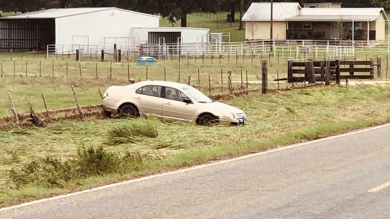 Car swept off road during flood in Bremond