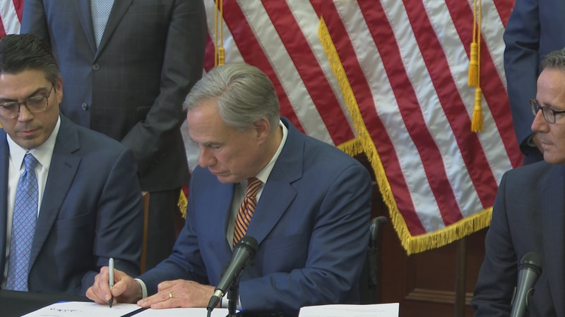 Governor Greg Abbott signs Senate Bills 2 and 3 into law.