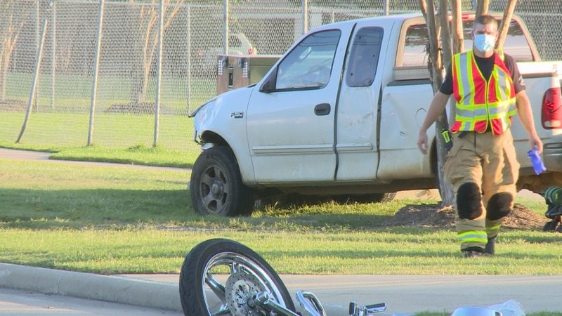 Police say the crash involved this white pickup truck and a motorcycle Sunday evening at the...