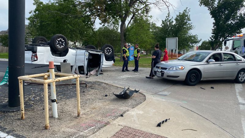 College Station police investigate a crash involving a pickup truck that rolled over Monday...