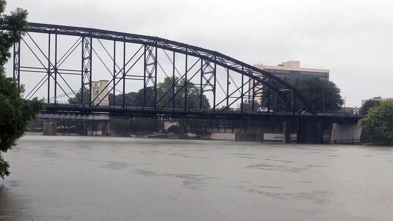 The Brazos River was swollen by runoff and filled with debris on Friday. (Photo by Montana...
