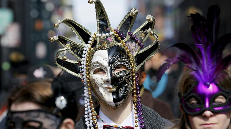 A reveller makes his way through the French Quarter on Mardi Gras in New Orleans, Louisiana...