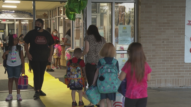 Johnson Elementary students into school on the first day.