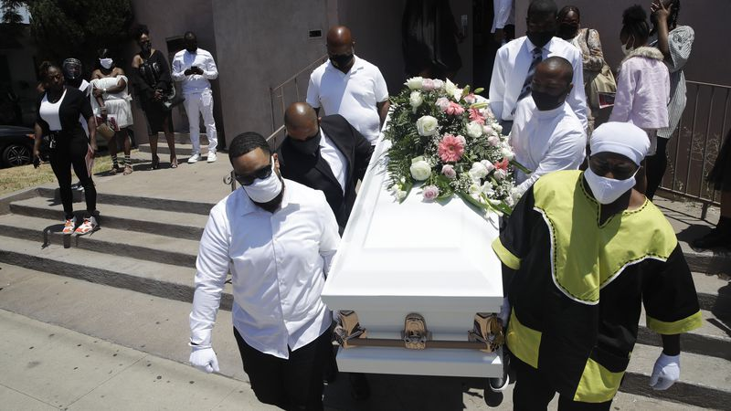 FILE - In this July 21, 2020, file photo, pall bearers carry a casket with the body of Lydia...
