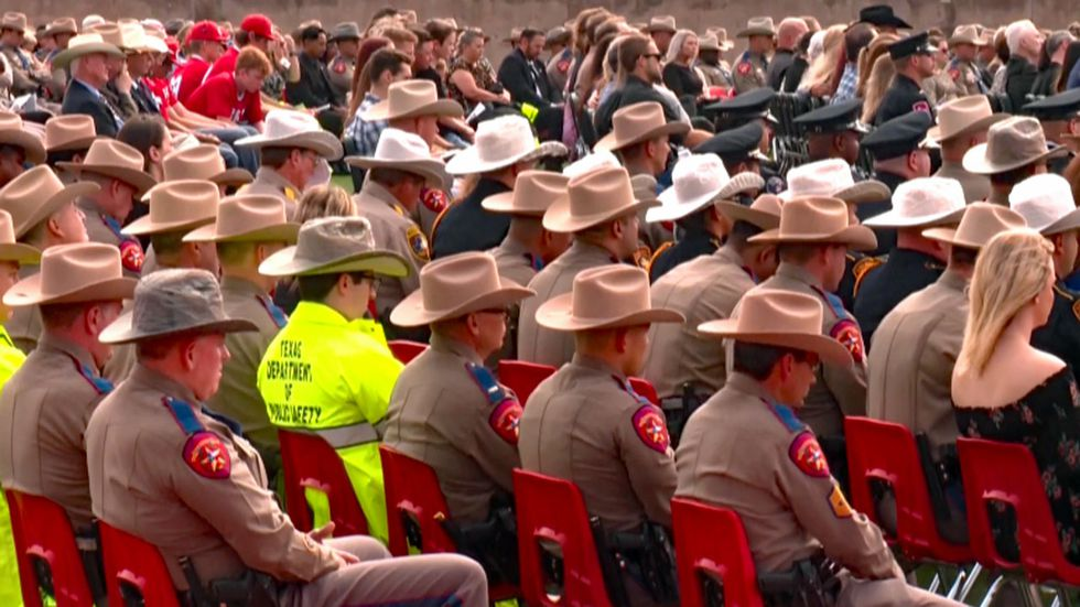 Friends, neighbors and law enforcement officers filled the 4,000-seat stadium.