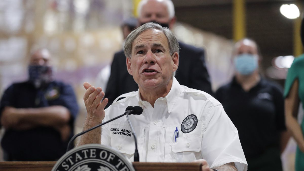 Texas Gov. Greg Abbott speaks to the media during a visit to a Texas Division of Emergency Management Warehouse filled with Personal Protective Equipment, Tuesday, Aug. 4, 2020, in San Antonio. (AP Photo/Eric Gay)