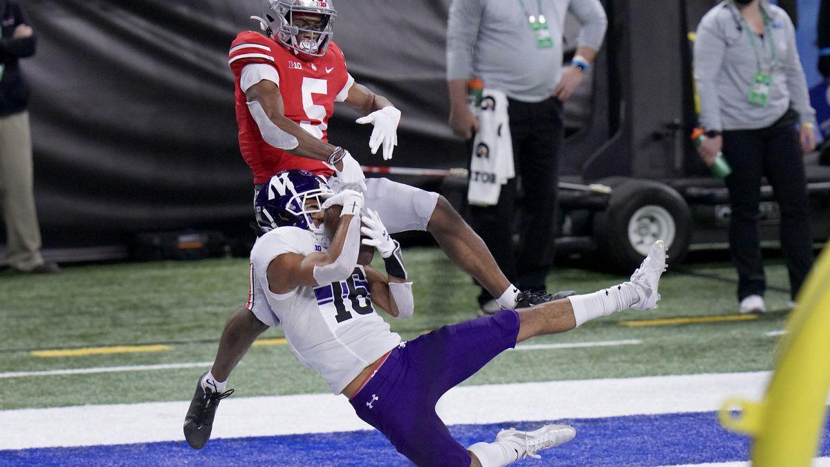 Northwestern defensive back Brandon Joseph (16) intercepts a pass intended for Ohio State wide...