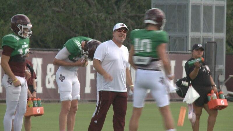 Texas A&M head football coach Jimbo Fisher coaches quarterback Zach Calzada during practice.