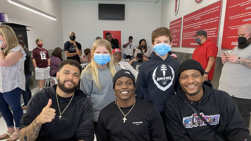Last Shot Xpresso grand opening. Mike Evans, Deshazor Everett, and Ricky Seals-Jones smile with...