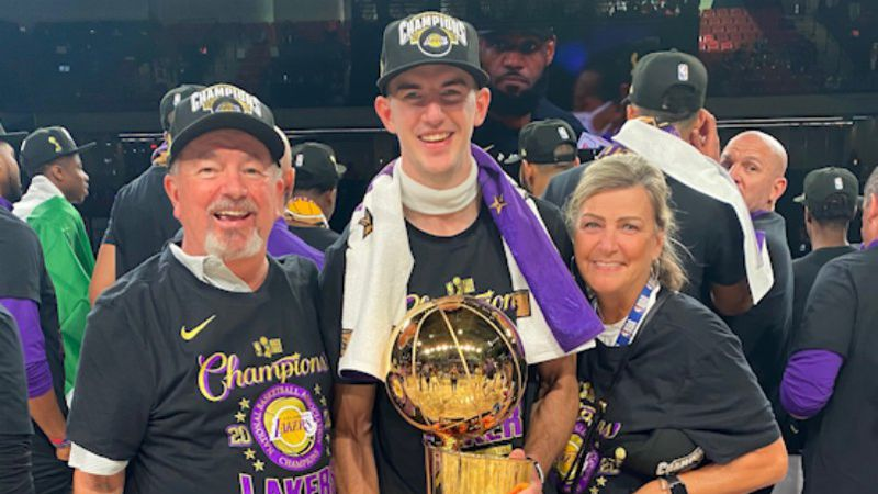 Los Angeles Lakers guard Alex Caruso with his parents after winning the NBA Championship.