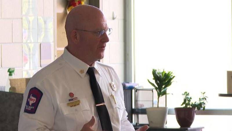 Bryan Fire Chief Rich Giusti speaks to the community duringThursday's meeting.