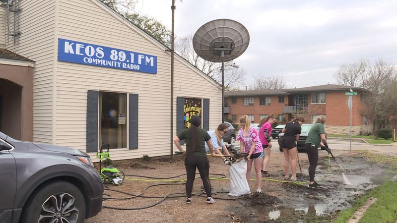 Members of the high school volleyball team helped with outdoor projects at KEOS 89.1 FM...