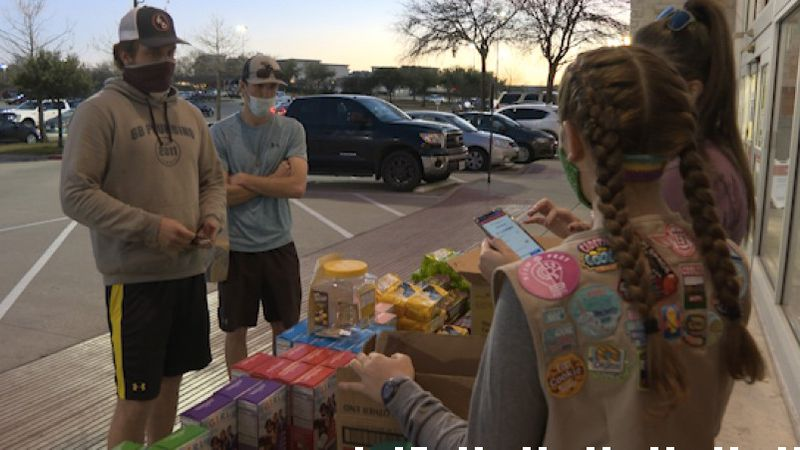 Local Girl Scouts sell cookies while following COVID-19 precautions.