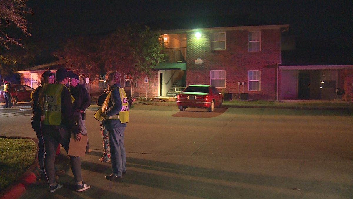 Response teams gather outside the apartment building on Dartmouth Street near Southwest Parkway.