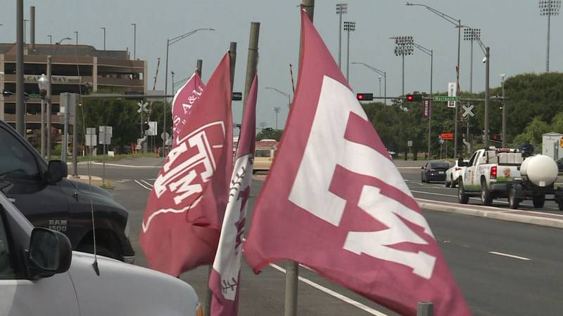 Aggie Flags line an area of businesses along George Bush Drive in College Station.