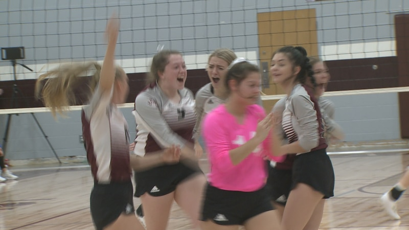 The Iola volleyball team celebrates during their home match against Leon.