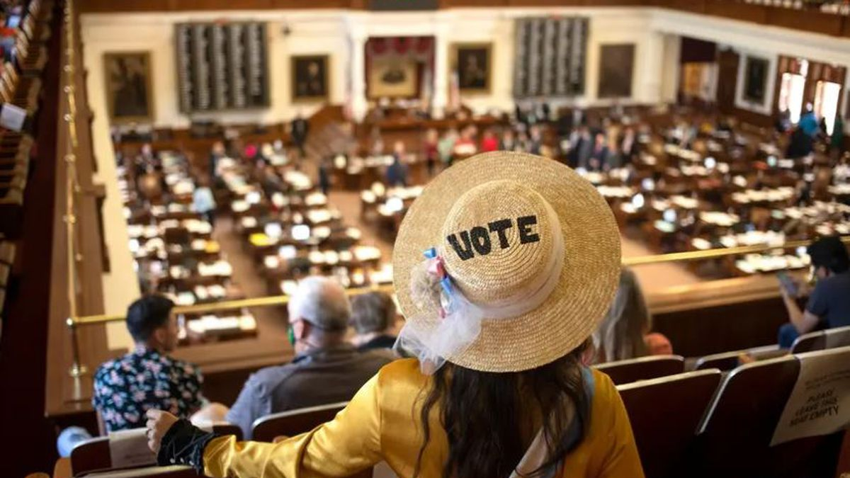 A member of the House gallery listens to legislators speak during a debate on an abortion bill...